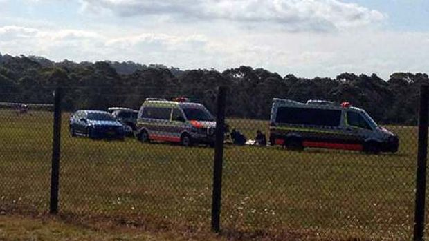 Shocking ... emergency services at Moruya airport Tuesday afternoon, amid reports a skydiver had died.