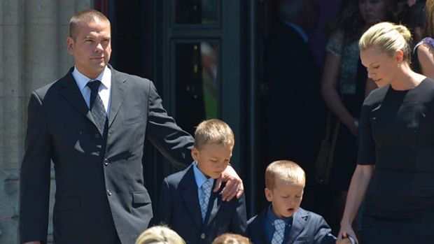 Lachlan Murdoch and his wife, Sarah, with their children, outside the cathedral.
