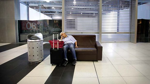 A man takes a break at the troubled Spencer Street outlet centre at Southern Cross station.