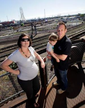 Railway Place residents Meredith and Richard Goss with their son Dylan.