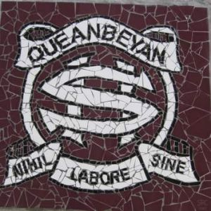 Queanbeyan High School Crest, done as a mosaic by kids at the school and erected above the stage in the hall.