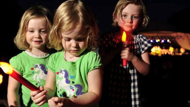 Twins Saskia, and Hannah Robinson, 3, and Georgia Maconachie, 5, of enjoying the Christmas Carols in Commonwealth Park.