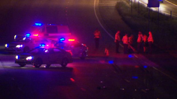 Police arrive at the scene of the accident on the M1 through Yatala.