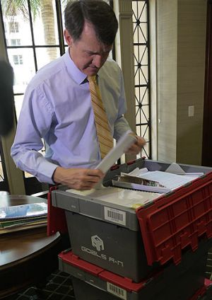 Lord Mayor Graham Quirk unpacks his boxes as he moves into his City Hall office.