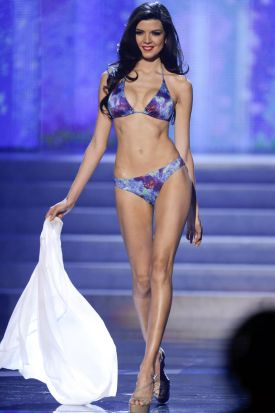 Miss Peru, Nicole Faveron, walks the stage during the swimsuit portion of the Miss Universe competition, Wednesday, Dec. ...