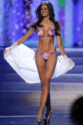 Miss Brazil, Gabriela Markus, walks the stage during the swimsuit portion of the Miss Universe competition, Wednesday, ...