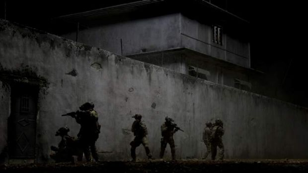 Everyone agrees on this part ... Navy SEALs raid Osama Bin Laden's compound in <i>Zero Dark Thirty</i>.
