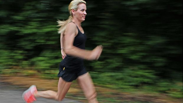 In action ... Suzy Favor Hamilton out for a run in July this year.