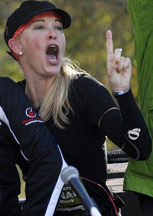 Suzy Favor Hamilton dances at the finish line after completing a half-marathon in November.