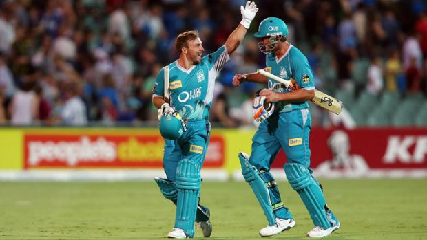Chris Hartley and Peter Forrest of the Heat celebrate after the Big Bash League match between the Adelaide Strikers and ...