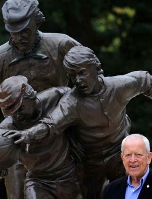 Dr Allen Aylett in front of Tom Wills statue at the MCG.