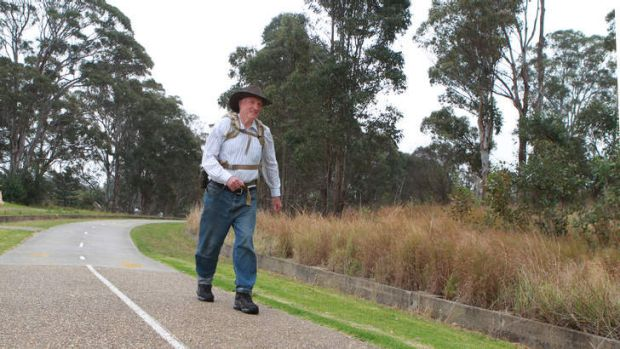 Malcolm Brown hits the road in preparation for his walk to Dubbo.