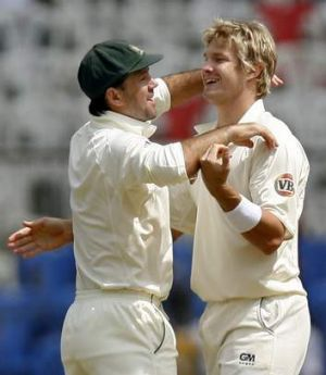 Mutual admiration: Ricky Ponting (left) and Shane Watson celebrate a wicket.