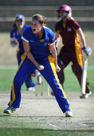 Meteors bowler Rene Farrell celebrates taking a wicket.