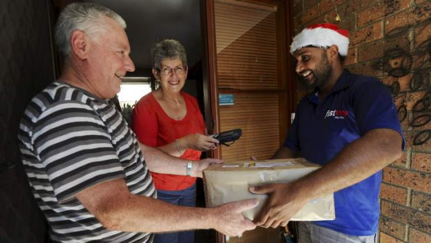 Courier driver, Mandip Singh, makes a final delivery for the day, at a home in Isaacs to Richard and Lois Cooper.