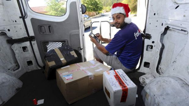 Courier driver, Mandip Singh, makes his final delivery for the day on Friday, to a home in Isaacs.