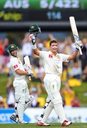 One more in the bag: Mike Hussey reaches a hundred against Sri Lanka in Hobart.