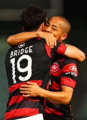 Treble ... Shinji Ono congratulates Mark Bridge.