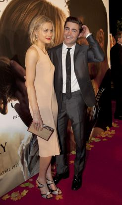 Taylor Schilling and Zac Efron at the premiere of <i>The Lucky One</i>.