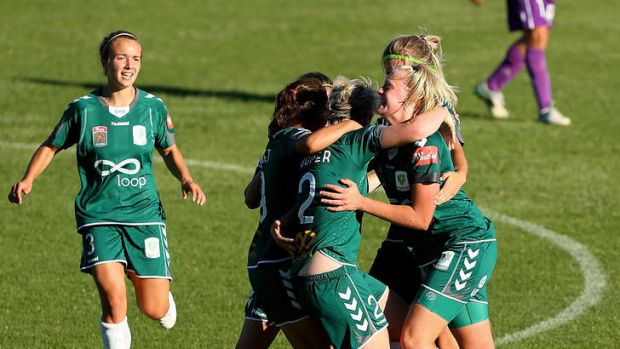 Canberra United's Caitlin Cooper gets mobbed by teammates after scoring the equaliser in the 3-3 draw with Perth.