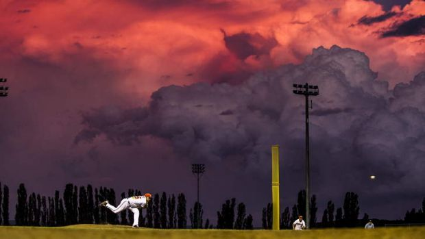 Cavalry pitcher Chis Motta in front of an impressive Canberra sunset.