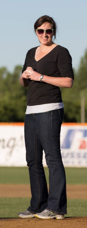 Canberra Times sports journalist Fleta Page readies herself to throw the first pitch at a Canberra Cavalry game.