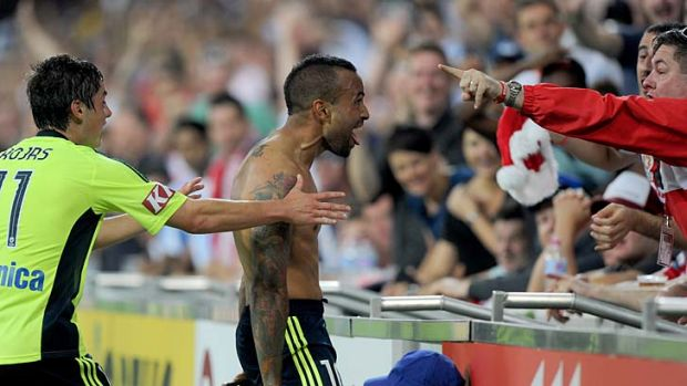 Victory's Archie Thompson celebrates after scoring the match-winner.
