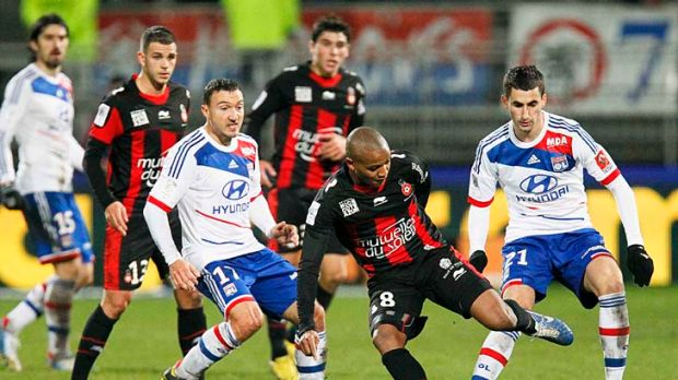 Olympique Lyon's Steed Malbranque (third left) challenges Mahamane Traore (second right) of Nice during their Ligue 1 ...