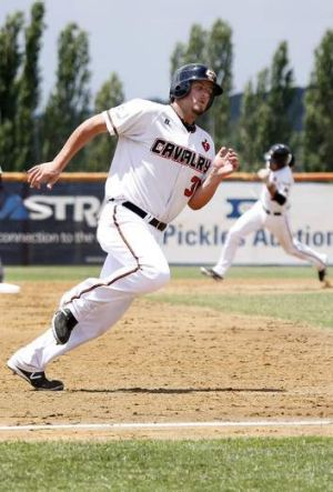 Cavalry's Aaron Sloan rounds third to add another run on Sunday.