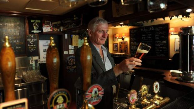 Owner of the Wig and Pen, Lachie McOmish , behind the bar of the Civic establishment.