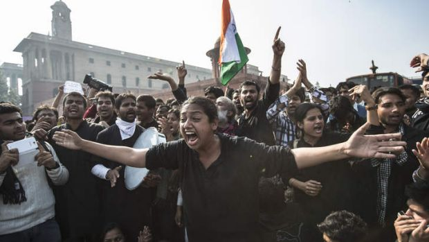 Anti-police slogans … protesters at the presidential palace in Delhi.