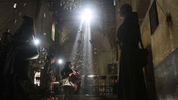Under pressure … a Christian monk and two worshippers in the Church of the Nativity in Bethlehem, traditionally ...