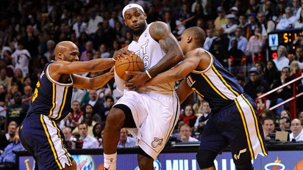 Jamaal Tinsley (left) and Randy Foye (right) of the Utah Jazz try to block the Heat's LeBron James.