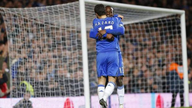 Magnificant eight ... Eden Hazard of Chelsea is congratulated by Victor Moses after scoring his team's seventh goal.