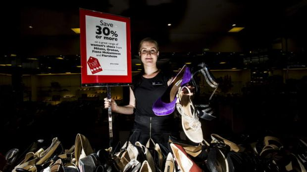 David Jones' Liz Tatham shows off some of the shoes that will be on sale on Wednesday.