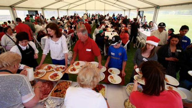 More than pies ... the Collingwood Christmas lunch for the homeless at  Victoria Park.