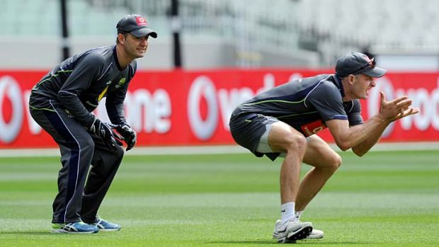 Race against time ... injured skipper Michael Clarke trains with Michael Hussey on Christmas Day.