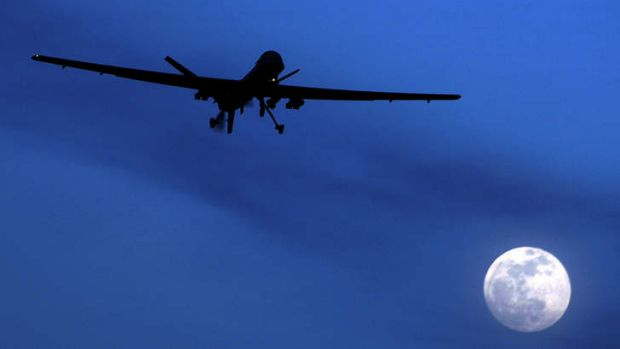 An unmanned US Predator drone flies over Kandahar Air Field.