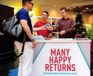 Samuel Koh and David Goode collect unwanted gifts.