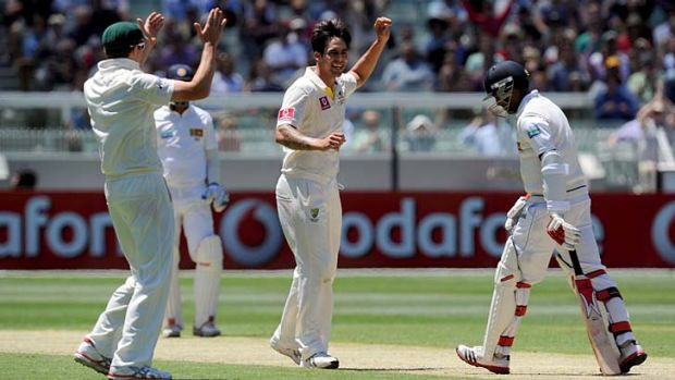 Too easy … recalled paceman Mitchell Johnson sees off Dhammika Prasad at the MCG on Wednesday.
