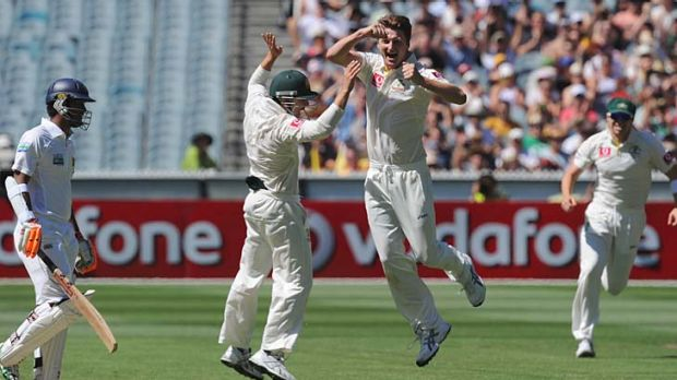 Jackson Bird celebrates his first Test scalp, that of Sri Lankan opener Dimuth Karunaratne.
