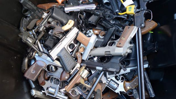 A bin full of handguns. By noon, police had collected more than 420 weapons.