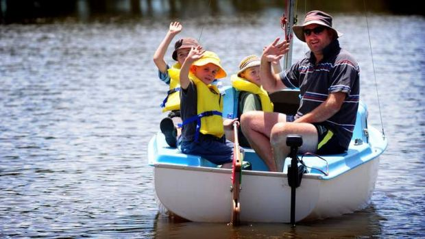 Gentle boating activity on Canberra's lake Burley Griffin. Sam Thomson takes his three sons Angus (5), Max (9) and Josh ...