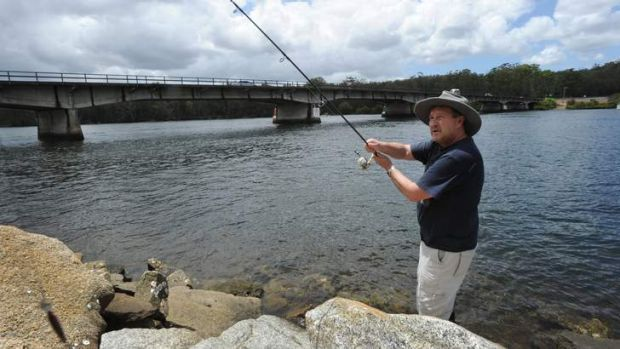 Canberran Rod Anthes fishes by Nelligen Bridge which needs to be repaired or replaced because of its deteriorating piles.