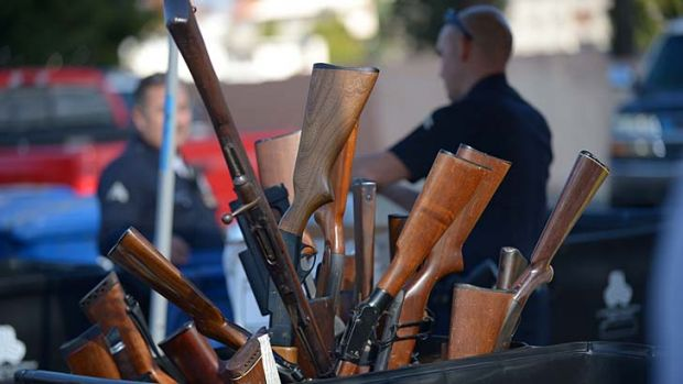 Not wanted ... a bin of rifles collected during the Los Angeles Police Department buy-back on Thursday, when hundreds of ...