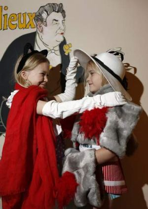 Alexandra Loney, 8, with sister Anna Loneg, 5, from Amaroo dress up in the Toulouse Lautrec Family Activity Room.