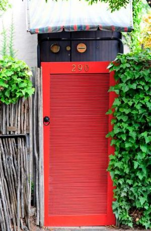 Red gate at the former South Yarra home of Robin Boyd.