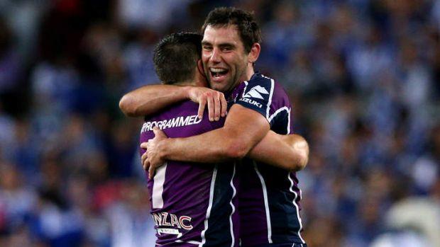 Cameron Smith and Cooper Cronk celebrate Melbourne's grand final win.