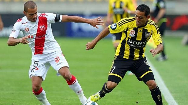 Duel … Phoenix's Leo Bertos and Fred, of Melbourne Heart, do battle in Wellington on Thursday.