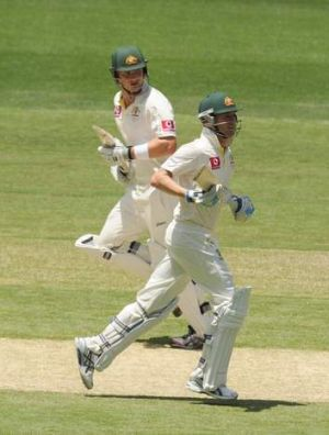 Michael Clarke and Shane Watson cross at the MCG.
